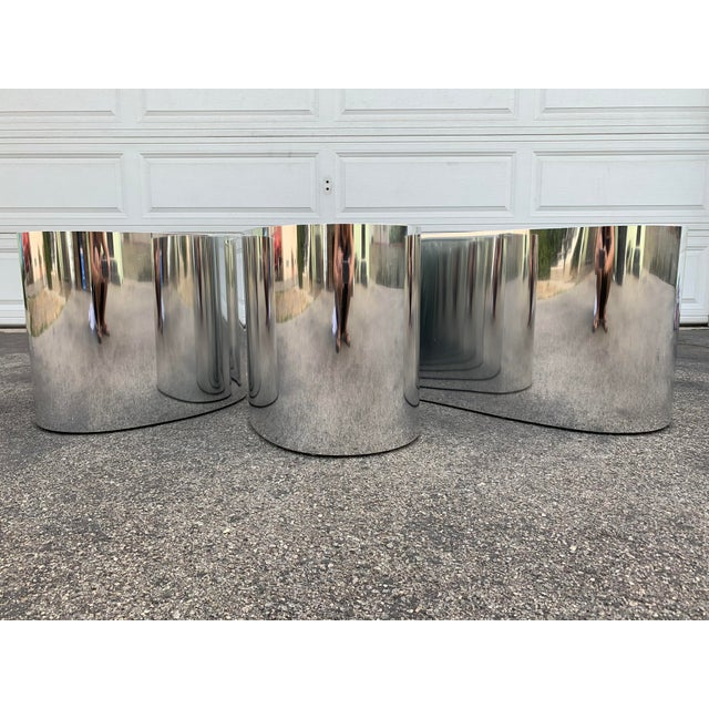 These is an amazing 3 piece designer chrome coffee table with organic shapes. Made of chrome sheets hand crafted shaped to...