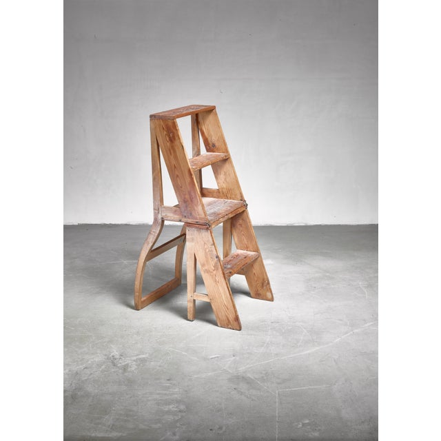 A 19th century pine, foldable step chair. This piece can be used as a small ladder or, by placing it upside down, as a chair.