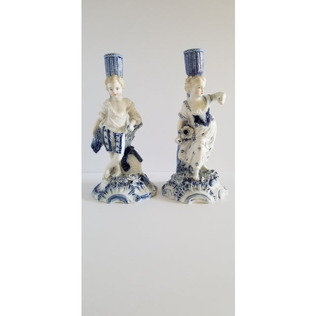 Antique circa 1720 Meissen porcelain Rococo candlesticks representing a young boy and a young woman harvesting in a...