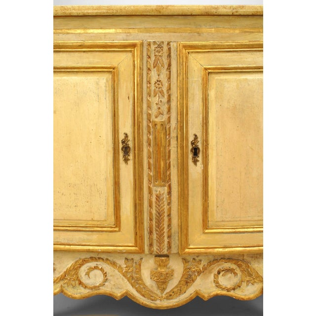 Turn of the 19th century Italian two-door chest/commode having a refreshed off-white painted finish with foliate gilt...