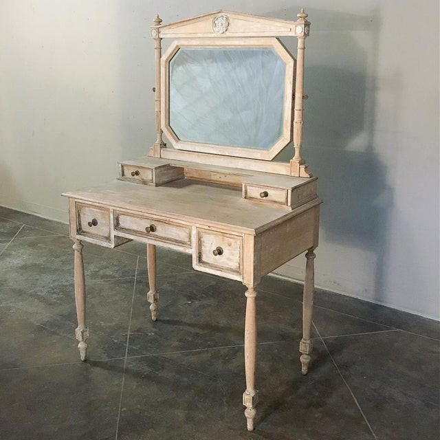 19th Century French Louis XVI Painted Vanity features a distressed painted finish and subtle classical detailing for a...