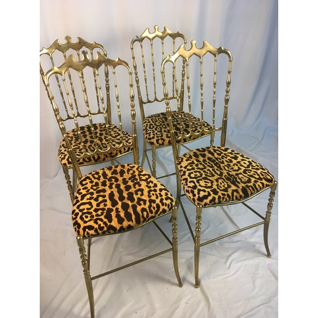 Wow! As accent chairs or dining chairs.. these vintage brass beauties are show stoppers! Reupholstered in beautiful animal...