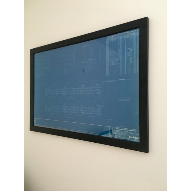 A vintage blueprint from the United Illuminating company, in Connecticut, circa 1947. Displayed in a timeless black frame.
