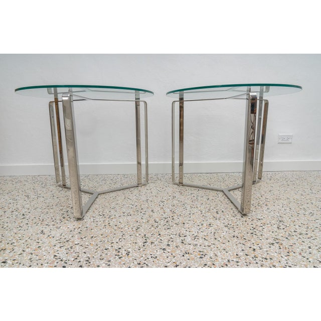 This stylish and chic pair of end tables are very much inspired by pieces created by Milo Baughman and they date to the...