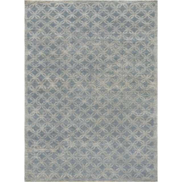 Created in Kashmir this high quality brand new modern rug features the distressed vintage look and the modern...
