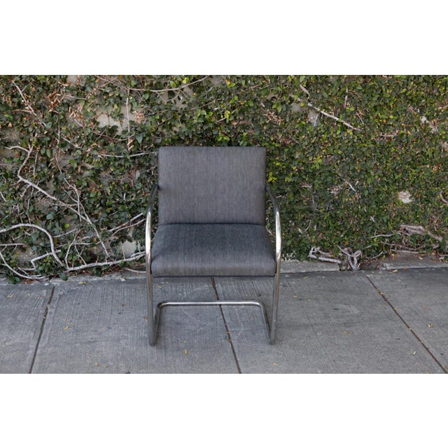 Really sleek bullet gray/blue upholstered side chair with curved chrome base and arms. Very slight discoloration in the...