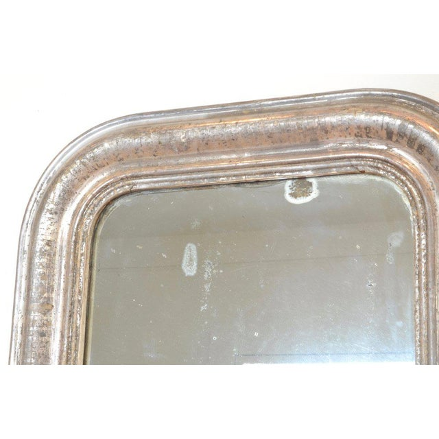 Small antique mirror from France with silver frame