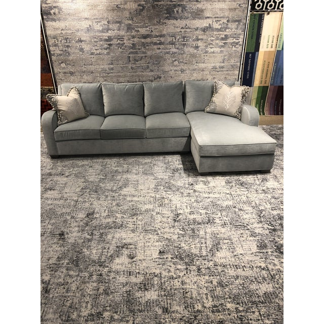 This transitional sectional was made in the Swaim factory in High Point North Carolina. It features a slope arm, left arm...