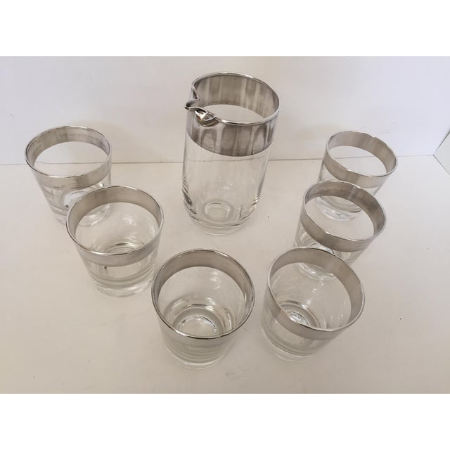 Dorothy Thorpe, unsigned ,silver banded drinks set consisting of 6 glasses and a pitcher with a spout Thorpe was known for...
