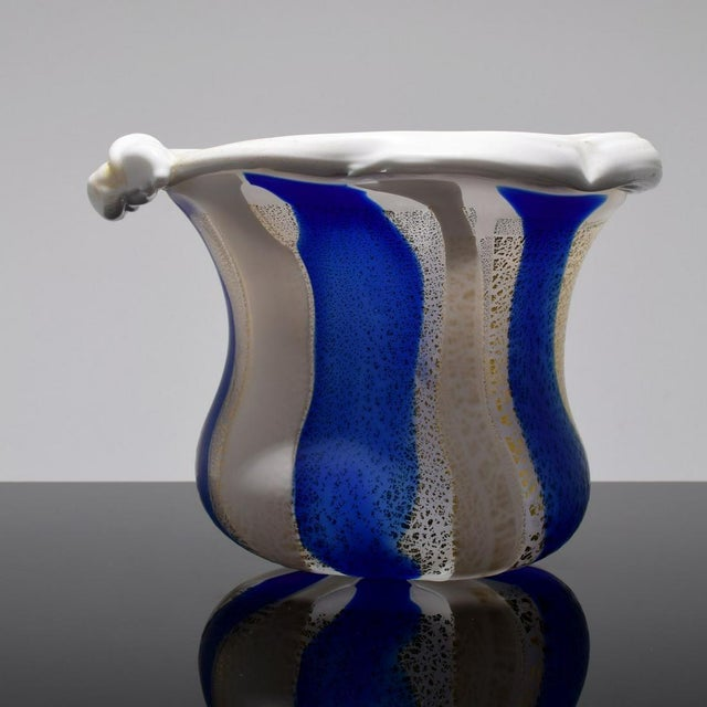 A free standing glass sculpture in an open vessel form by Kyohei Fujita (1921-2004). The striking piece features an...