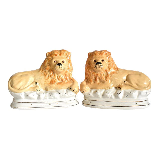 Mid 20th Century Vintage Staffordshire Style Recumbent Lions - a Pair For Sale