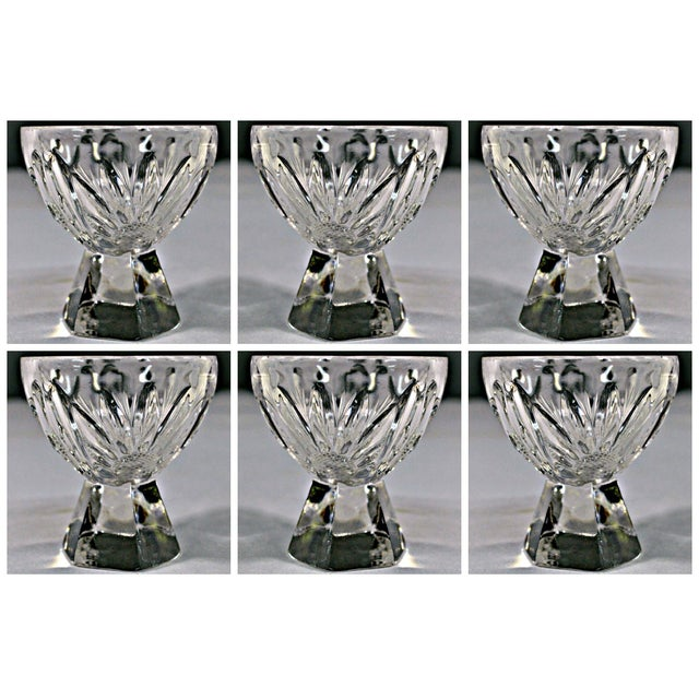 Glamorous set of 6, cut crystal egg cup holder with solid crystal pyramidal faceted base. A couple of cups has minimum...