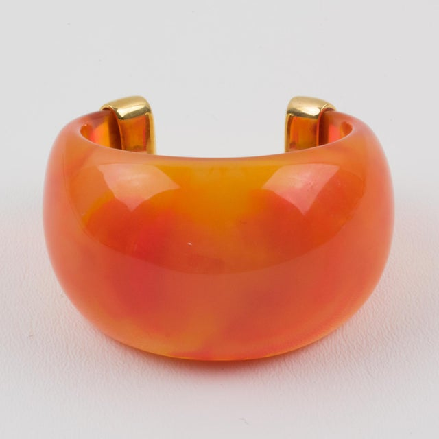 Yves Saint Laurent YSL Paris cuff bracelet. Massive resin bracelet, featuring a heavily domed cuff in translucent bright...