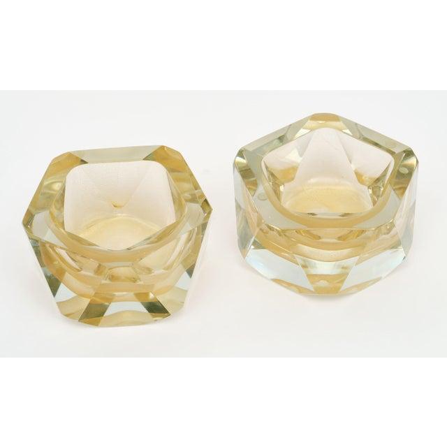 A pair of Murano glass hand-blown avventurina bowls made and signed by glass maestro Alberto Dona. The avventurina...