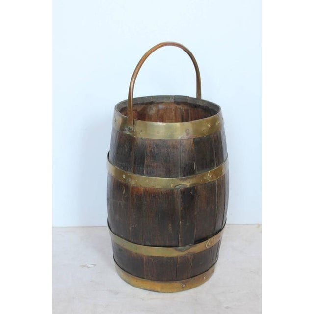 Antique brass and wood umbrella stand or waste basket.