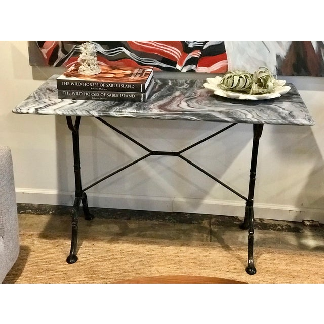 A lovely marble french bistro table, from the 1920s. Gorgeous grey marble table top with a black iron base.