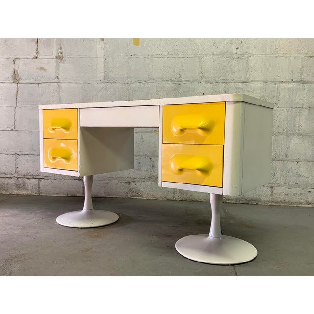 Extremely rare Broyhill Premier Chapter One Desk. Crafted from molded vibrant yellow plastic drawers encased in white...