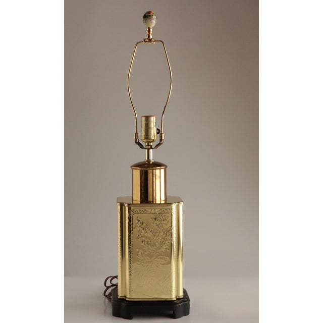 """This Asian brass canister lamp base features an elegantly embossed floral motif. It measures 25.5"""" to the top of its..."""