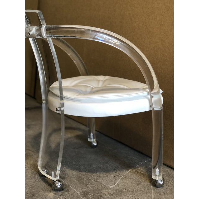 Lucite dining chairs on wheels are a great way to add a contemporary spin to your kitchen or dining area. The white...