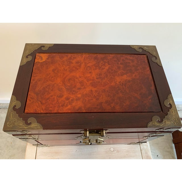 Beautiful high quality unique vintage hand made silk lined Asian jewelry box with flame mahogany inlays. Plenty of floral...