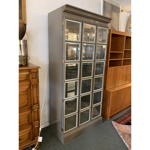 Design Plus Gallery presents a Large Gray Lacquered Custom Lighted Display Cabinet. Modern grey lacquer applied to...