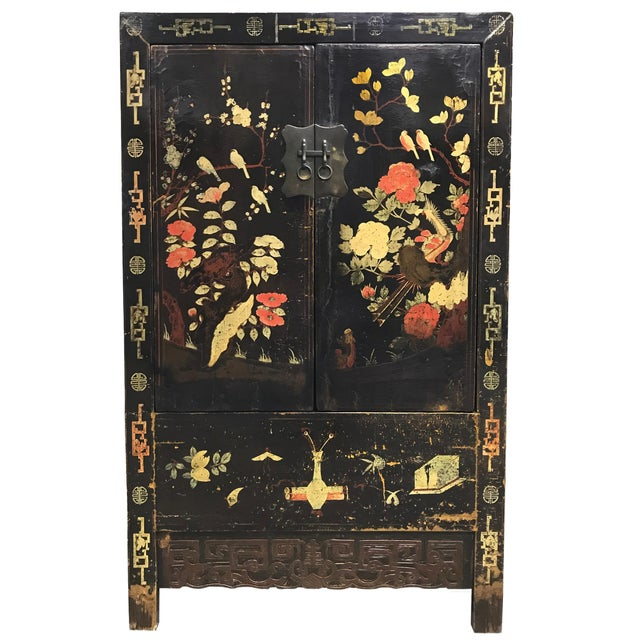 A wonderful pair of 19th century Chinese cabinet with a heavy black lacquer and beautifully painted garden scenes...