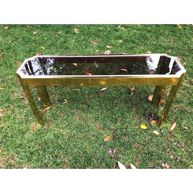 Classic, refined 1970's Baughman style brass and smoked glass console table with chrome detailing. *52 inches across