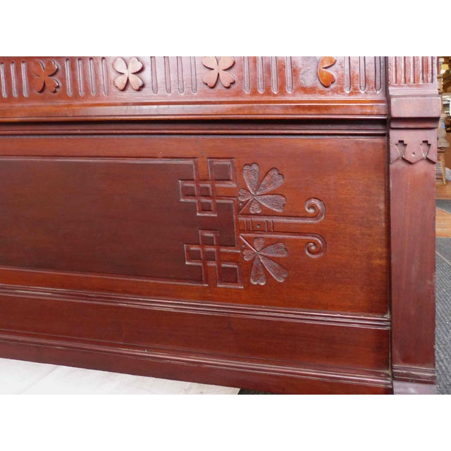 Late 19th century Aesthetic Movement mahogany double bed frame. The mahogany has a patina. The footboard height is 30 inches.