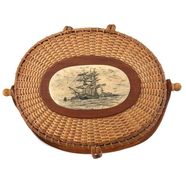 This is a Nantucket basket with whale tooth ivory scrimshaw, lock, and hinges accompanied by federal exemption paperwork....