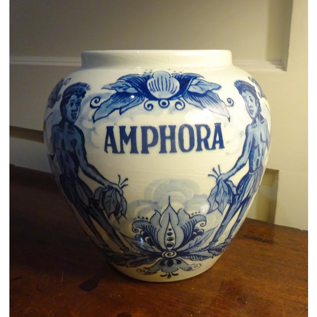 """*Amphora"""" Delft Hand-painted Jars Interesting motif of natives holding bunches of tobacco leaves and wearing skirts made..."""
