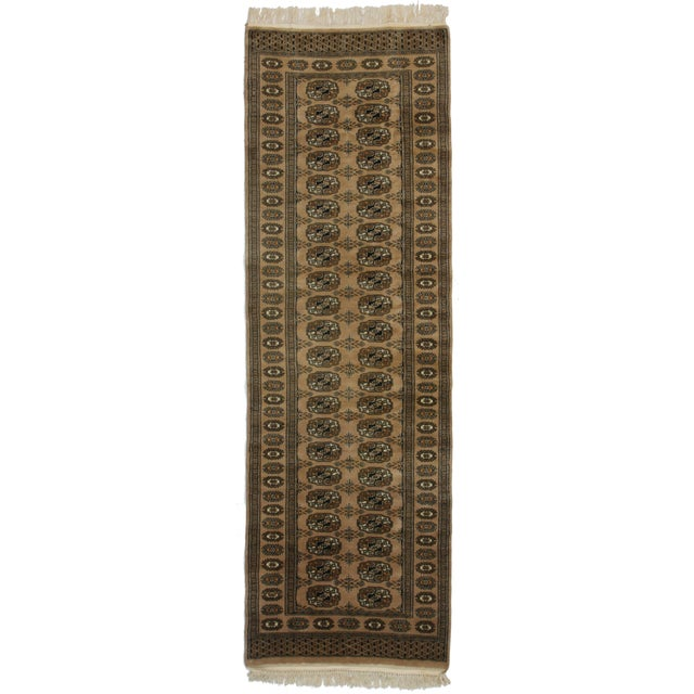 Offered is a vintage Bokhara hand knotted wool runner rug. Handmade in Pakistan.
