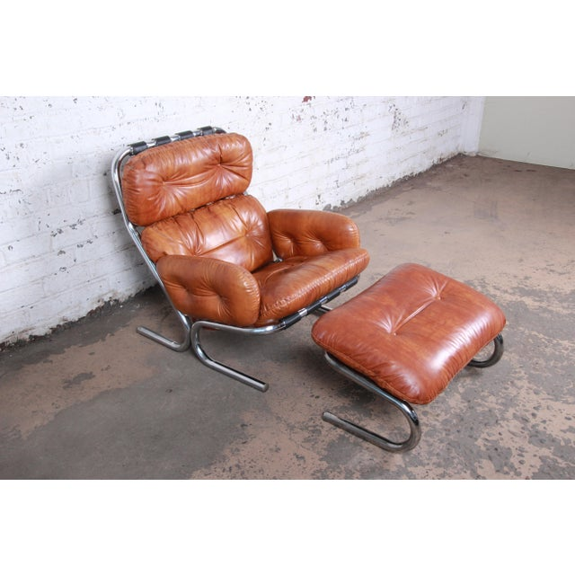 An exceptional all original lounge chair and ottoman designed by Milo Baughman for Directional. The set features the...