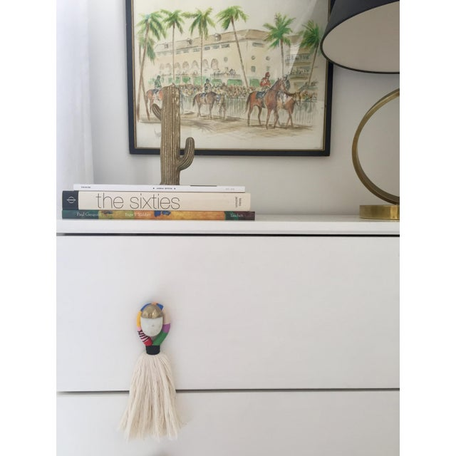 Our handmade 'hula' multi-color cotton tassel door or knob hanger is a quick & fun accessory to add to your door, on a...