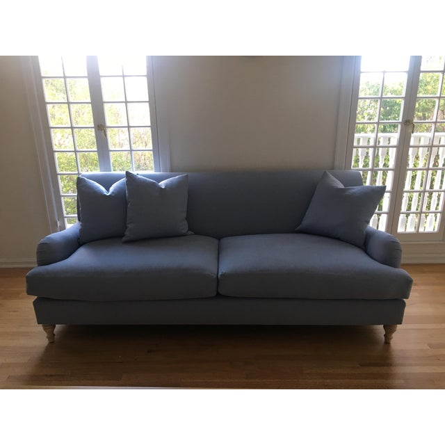 Traditional English Roll arm sofa newly reupholstered in a periwinkle linen. All cushions are newly made with down and...