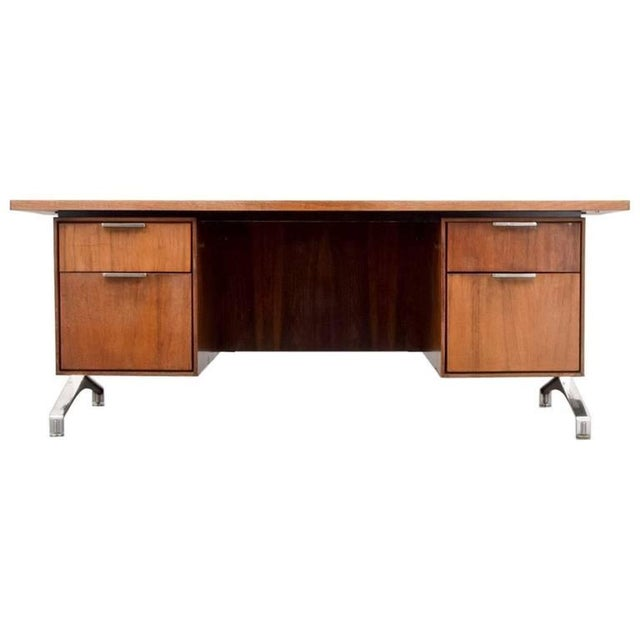 Beautiful rosewood desk with rounded front and chrome legs. Matching credenza available for $3495.