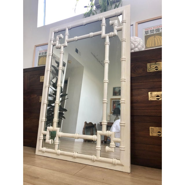 Vintage large white faux bamboo wall mirror with Greek key detail at the corners. Heavy and sturdy with 2 hooks on the...
