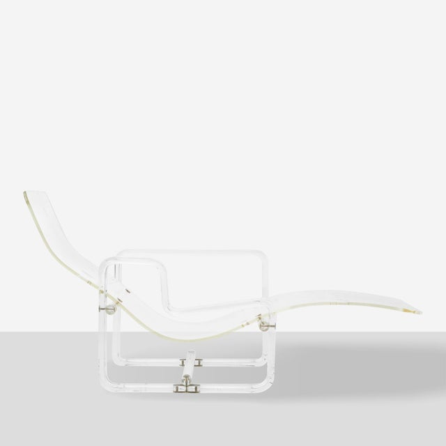 An all Lucite adjustable chaise longue by Charles Hollis-Jones. Brass hardware with cut-out areas meant to hold the...