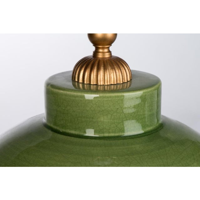 A modern pearl drop table lamp adds posh appeal with its ceramic body and green finish. Adding subtle color when combined...