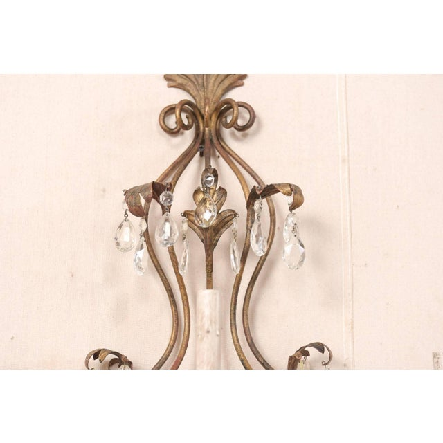 Brown Pair of Mid-Century Seven-Light Crystal and Iron Sconces With Leaf Crest Tops For Sale - Image 8 of 11