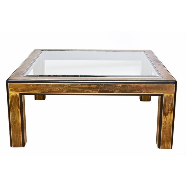 This vintage Bernhard Rohne for Mastercraft square cocktail table has acid etched abstract designs. it is black mat...