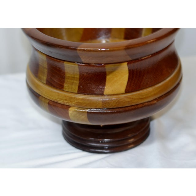 A very unique piece, this wooden footed bowl is in like new condition. Made with a variety of wood tones and grains, this...
