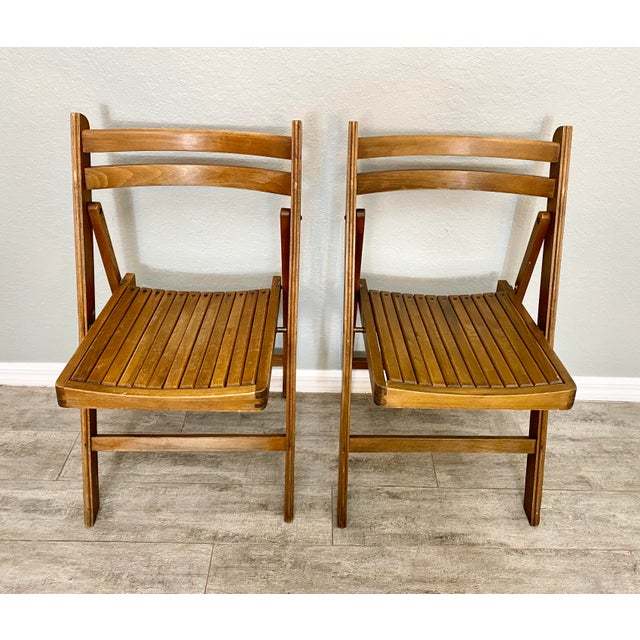 Pair of mid century modern folding chairs in amazing condition. The perfect addition to any room. Sturdy and solid.