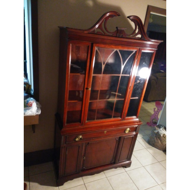 """Beautiful mahogany china cabinet in very good condition. It measures approx 41"""" left to right, x 16"""" front to back 76""""..."""