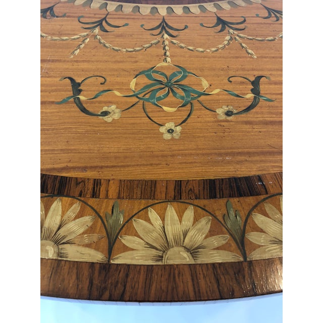 Sublime satinwood demilune console table having meticulous hand painted decoration and inlay in rosewood and ebony.