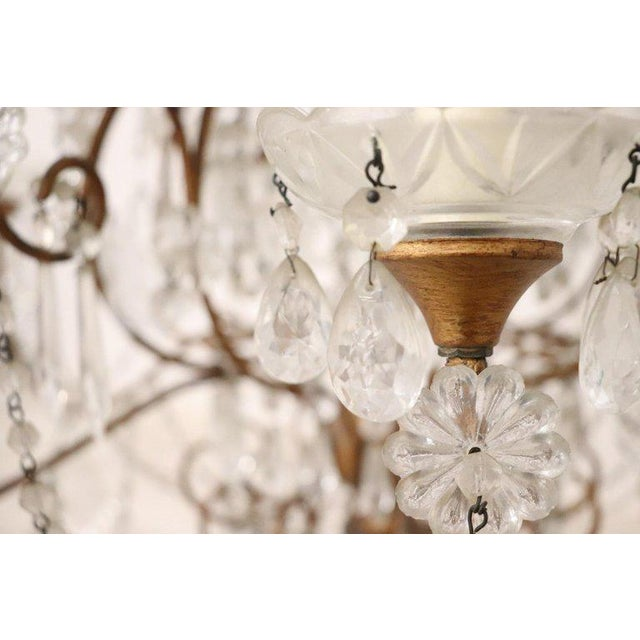 Beautiful and refined Italian Louis XVI style, circa 1940s chandelier eight lights. In gilded bronze and completely...