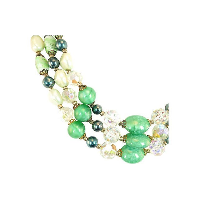 Offered here is an Austrian multi-strand draping necklace from the 1950s. There are three strands of graduated crystal and...