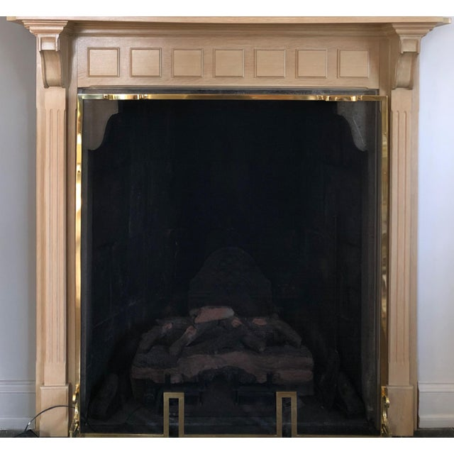Up for sale is a beautiful, unique, solid white oak fireplace surround with framed mirror. This set was commissioned to a...