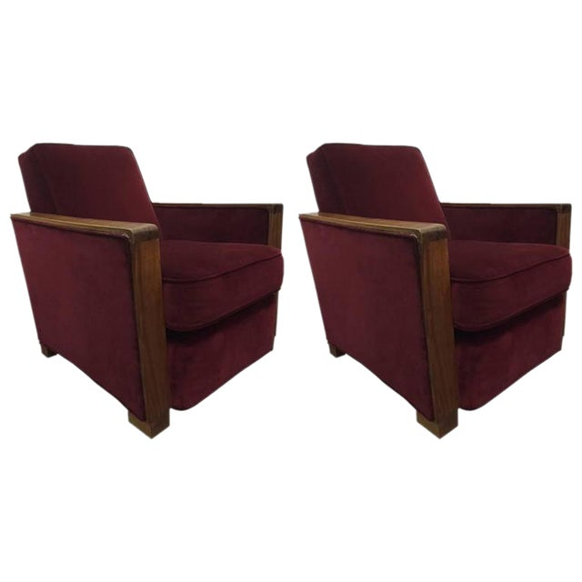 Pair of art deco club chairs which retains the original velvet fabric with walnut arms and trim. Attributed to Jacques Adnet.