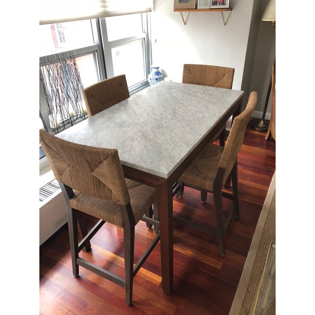 This custom-made Crate & Barrel exclusive dining table includes a polished Italian Carrara marble top, set on a natural...