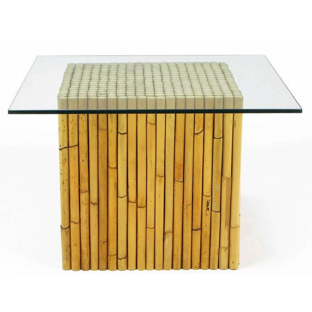 Uncommon reeded bamboo custom designed square based end or coffee table with one-half inch thick polished edge glass top....
